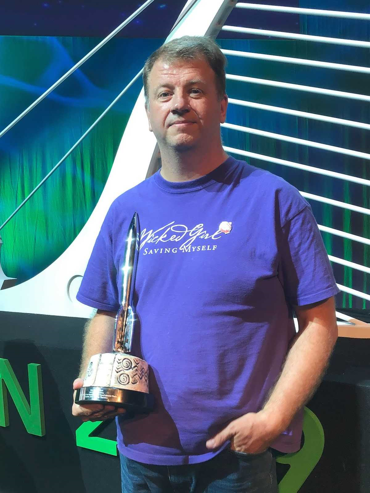 james_ holding the AO3's Hugo Award